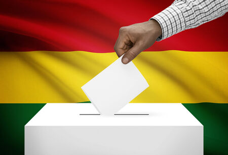 electoral system: Ballot box with national flag on background - Bolivia