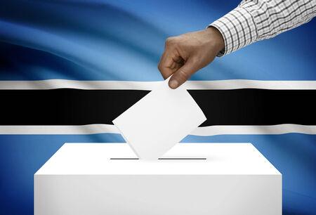 botswanan: Ballot box with national flag on background - Botswana