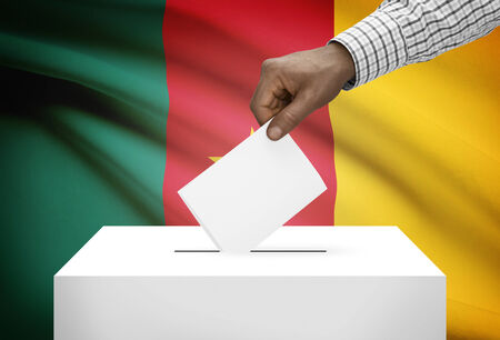 Ballot box with national flag on background - Cameroon photo