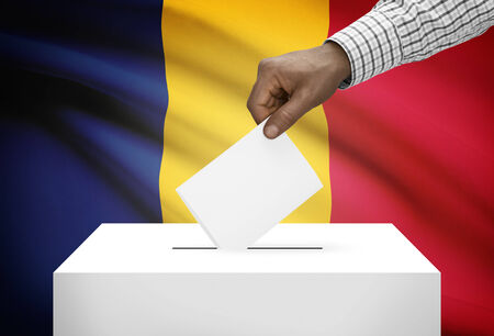 chadian: Ballot box with national flag on background - Chad