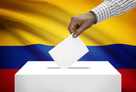 political system: Ballot box with national flag on background - Colombia