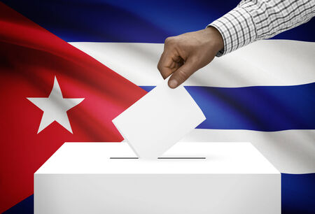 polling booth: Ballot box with national flag on background - Cuba Stock Photo
