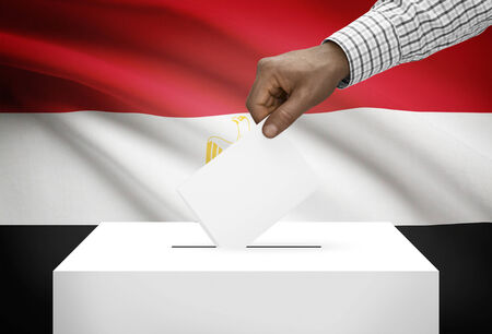 electoral system: Ballot box with national flag on background - Egypt