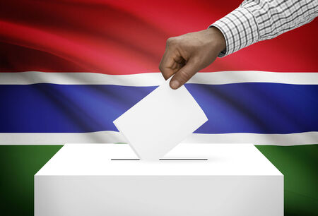 political system: Ballot box with national flag on background - Gambia