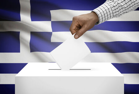 political system: Ballot box with national flag on background - Greece Stock Photo