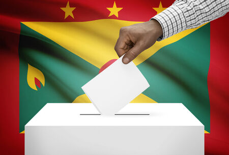electoral system: Ballot box with national flag on background - Grenada Stock Photo