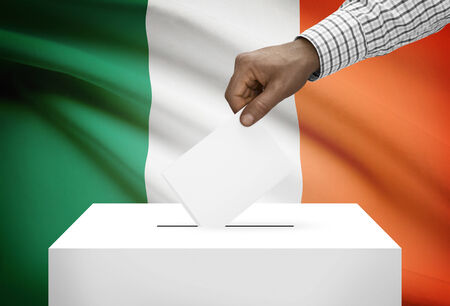 electoral: Ballot box with national flag on background - Ireland Stock Photo