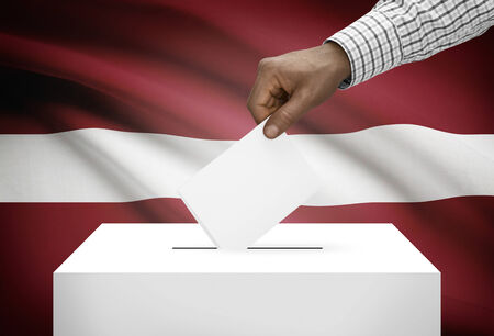 political system: Ballot box with national flag on background - Latvia