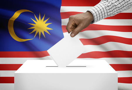 vote: Ballot box with national flag on background - Malaysia Stock Photo