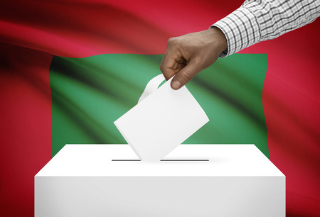 political system: Ballot box with national flag on background - Maldives Stock Photo
