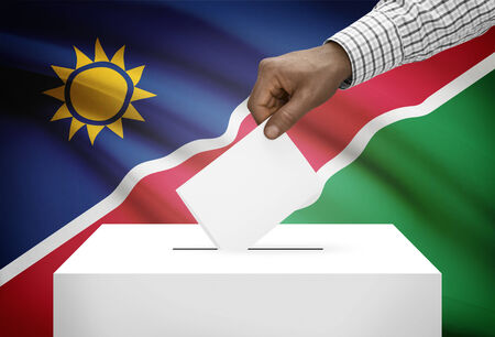 political system: Ballot box with national flag on background - Namibia