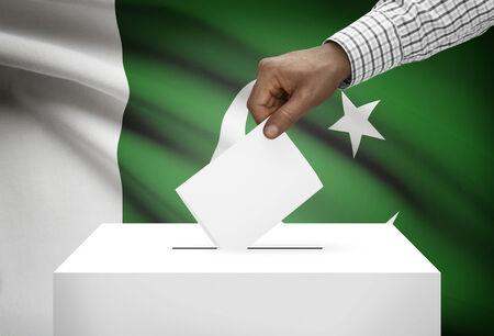 Ballot box with national flag on background - Pakistan photo