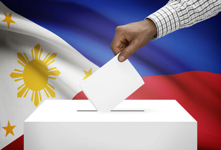 Ballot box with national flag on background - Philippines photo