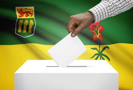 saskatchewan: Voting concept - Ballot box with Canadian province flag on background - Saskatchewan Stock Photo