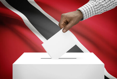 electoral system: Ballot box with national flag on background - Trinidad and Tobago Stock Photo