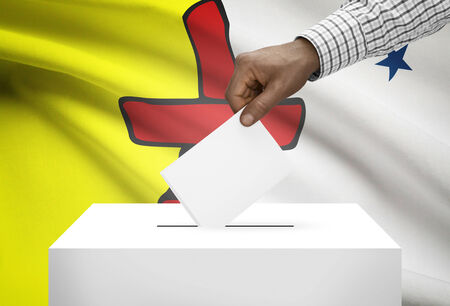 electoral system: Voting concept - Ballot box with Canadian province flag on background - Nunavut Stock Photo