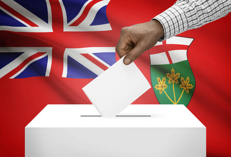 ballot box: Voting concept - Ballot box with Canadian province flag on background - Ontario