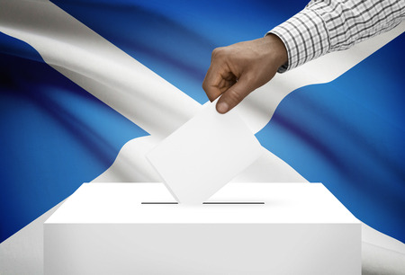 scottish parliament: Ballot box with national flag on background - Scotland