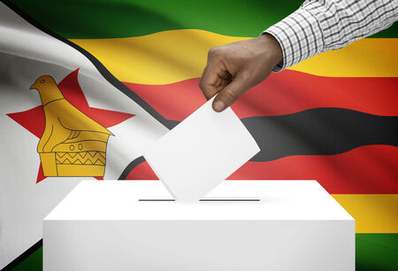 Ballot box with national flag on background - Zimbabwe photo