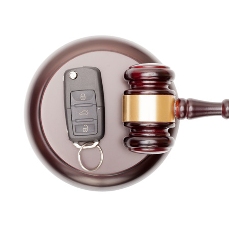 Wooden judge gavel and car keys over sound box - view from top Stock Photo