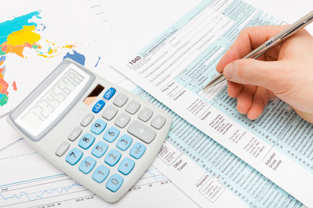 taxable income: Male filling out US 1040 Tax Form