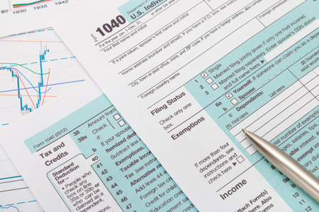 tax return: US 1040 Tax Form and silver ball pen