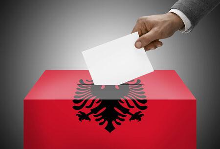 Ballot box painted into national flag colors - Albania photo