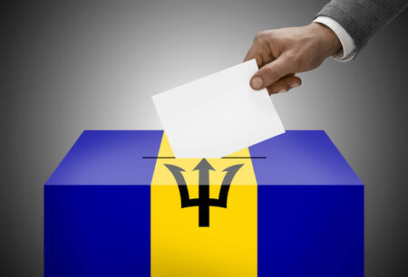 barbadian: Ballot box painted into national flag colors - Barbados