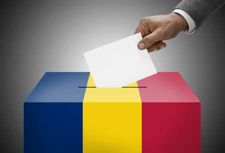 chadian: Ballot box painted into national flag colors - Chad