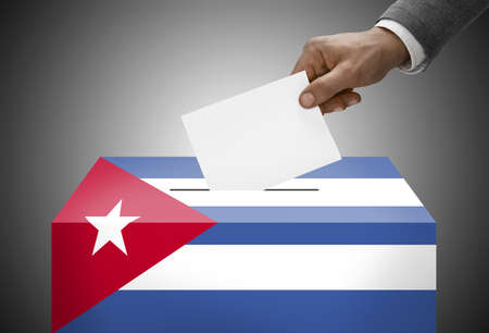 Ballot box painted into national flag colors - Cuba photo