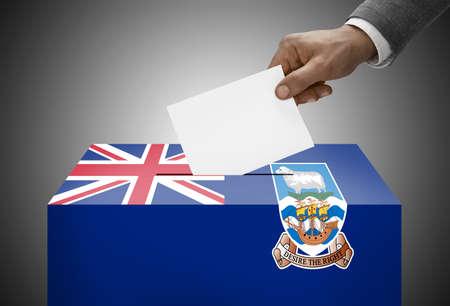 falkland: Ballot box painted into national flag colors - Falkland Islands Stock Photo