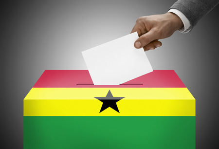 electoral system: Ballot box painted into national flag colors - Ghana Stock Photo