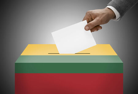 electoral system: Ballot box painted into national flag colors - Lithuania Stock Photo