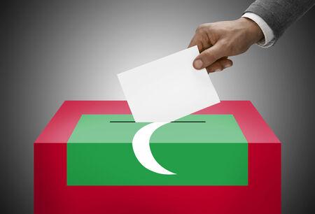 electoral system: Ballot box painted into national flag colors - Maldives