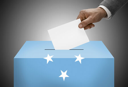 federated: Ballot box painted into national flag colors - Federated States of Micronesia Stock Photo