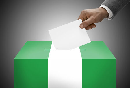 local election: Ballot box painted into national flag colors - Nigeria Stock Photo