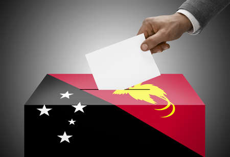 electoral system: Ballot box painted into national flag colors - Papua New Guinea