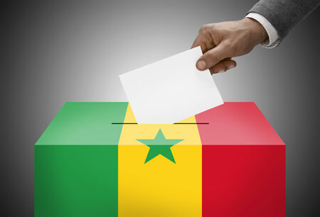 polling booth: Ballot box painted into national flag colors - Senegal