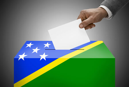 polling booth: Ballot box painted into national flag colors - Solomon Islands