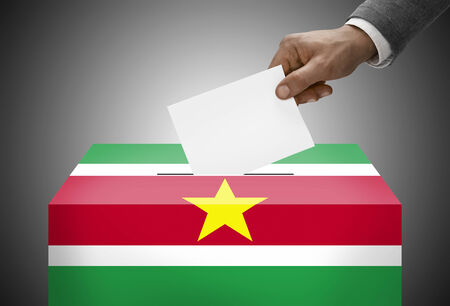 electoral system: Ballot box painted into national flag colors - Republic of Suriname