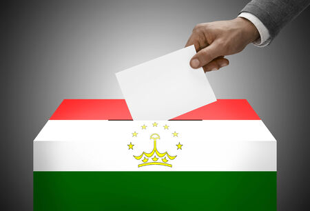 electoral system: Ballot box painted into national flag colors - Tajikistan