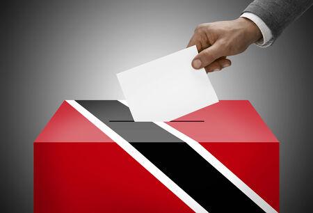 national flag trinidad and tobago: Ballot box painted into national flag colors - Trinidad and Tobago Stock Photo