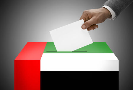 polling: Ballot box painted into national flag colors - United Arab Emirates Stock Photo
