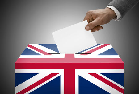 electoral system: Ballot box painted into national flag colors - United Kingdom Stock Photo