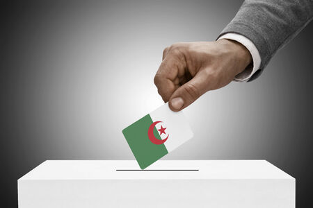 elect: Ballot box painted into national flag colors - Algeria Stock Photo