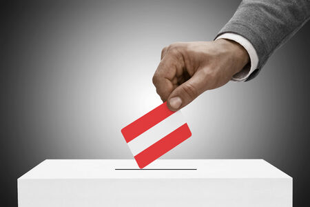 elect: Ballot box painted into national flag colors - Austria Stock Photo