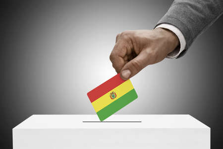 elect: Ballot box painted into national flag colors - Bolivia Stock Photo