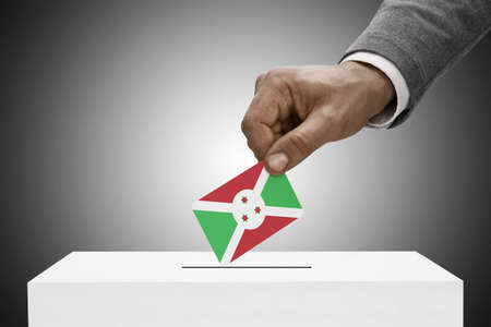 polling booth: Ballot box painted into national flag colors - Burundi Stock Photo