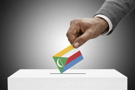 elect: Ballot box painted into national flag colors - Comoros Stock Photo