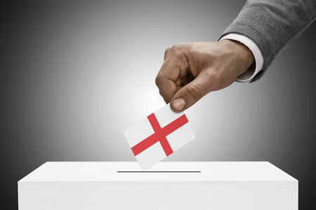 elect: Ballot box painted into national flag colors - England Stock Photo